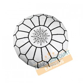 White leather pouf with black arabesques