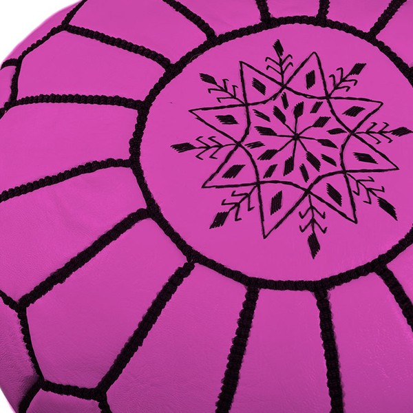 Pouf en cuir rose fuchsia avec arabesques noirs