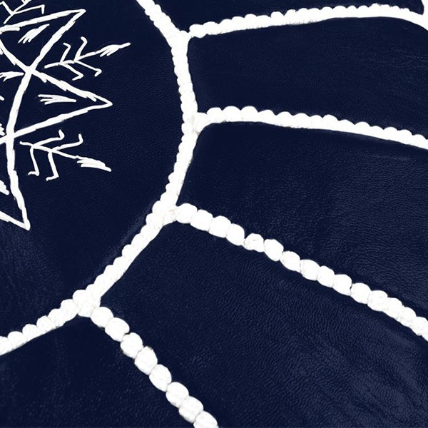 Midnight blue leather pouf with white arabesques