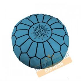 Pouf en cuir bleu ciel avec arabesques noirs