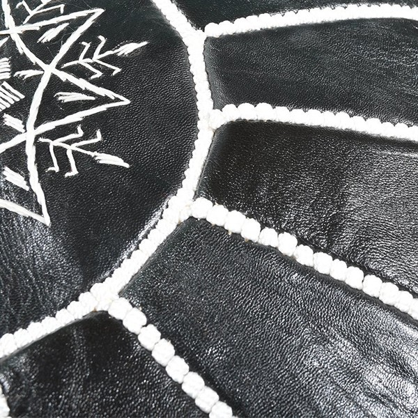 Black leather pouf with white arabesques