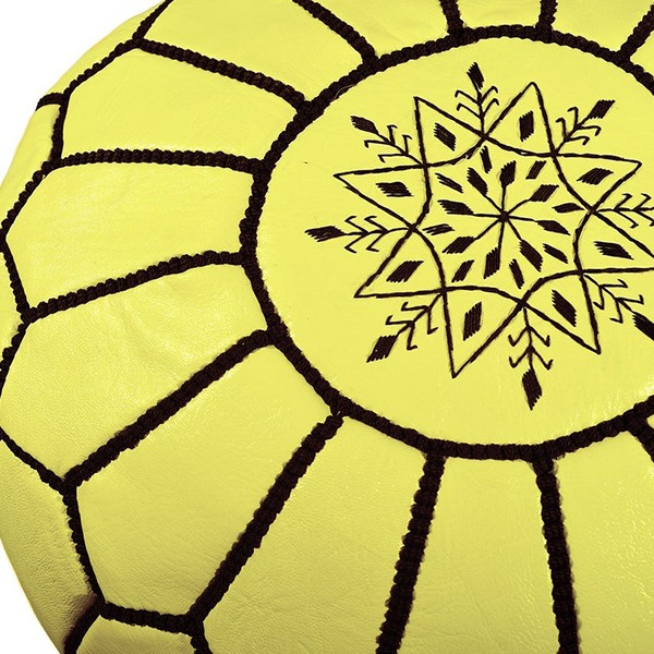 Yellow leather pouf with black arabesques